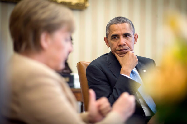 German chancellor Angela Merkel speaks with American president Barack Obama in the Oval Office of the White House in Washington DC, February 9