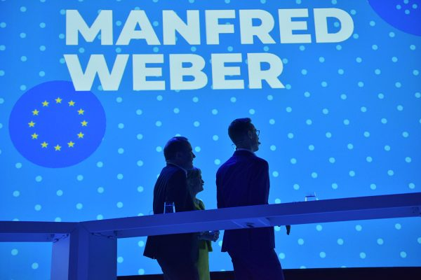 Leadership candidates Manfred Weber and Alexander Stubb enter the stage at a European People's Party conference in Helsinki, Finland, November 7