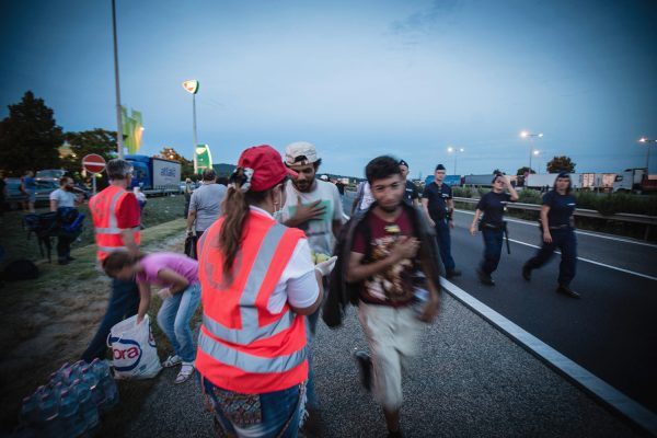 Red Cross workers provide first aid to migrants in Hungary, September 4, 2015